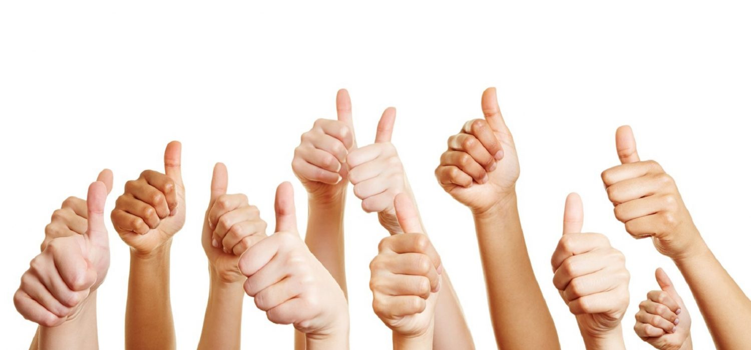 21852077 - many people congratulate a winner and holding their thumbs up