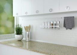 31643371 - kitchenware and utensils on the marble worktop. white kitchen design.